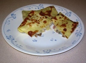 Filled Crepes with Ham and Mushrooms in Bechamel Sauce